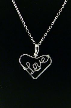 """Sterling Silver Filled Wire """"Love"""" Heart Pendant Necklace. $34.95, via Etsy."""