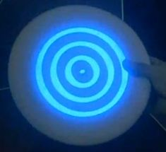 Make your own tron disc from paper plates and glow in the dark paint