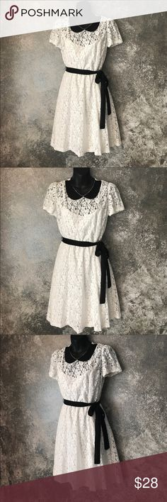 """Off-white Lace lined 50's style collar swing dress This adorable dress has the collar that is reminiscent of 50's style dress. The cream or off-white lace is a Rose design and the dress is lined. Black tie. Zip back. Size large. Brand is HeartSoul. Worn once for a costume party and received a ton of compliments. Good condition. Measures approximately 36"""" bust and approximately 32"""" in length. Smoke free home. Bundle with other items in my closet to save even more. Dresses Mini"""