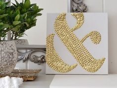 This takes pushpin art to the extreme! Looks like a really fun way to make some custom monogrammed art.