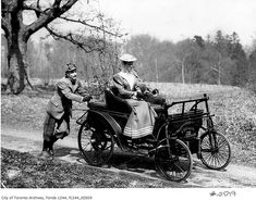 A man pushing a woman in an early automobile, Toronto, c. 1900. #vintage #Canada…