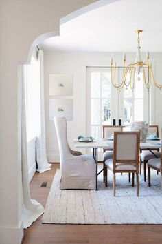 Arch to Dining Room & a touch of Gold @gabby chandelier Jessica Conner Design & Interiors