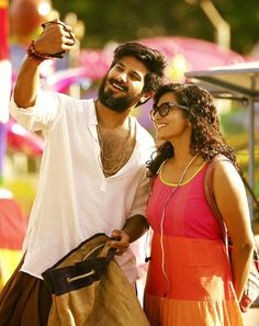 Parvathy and Dulquer Salmaan Taking Selfie-2617 Charlie Malayalam movie 2015 stills-Dulquer Salman,Parvathy