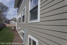 A sleek exterior with Hardie siding replacement from Opal Enterprises in Monterey Taupe color.  #OpalCurbAppeal