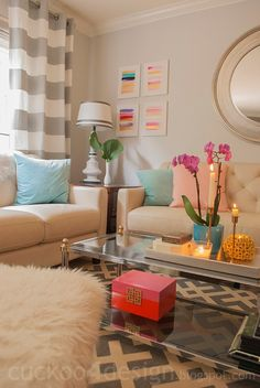 Love this living room color scheme, my couches are similar (about two shades darker). This could work!