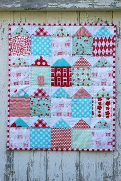 Red and Aqua Houses - with author's note on how she cut shapes.  It's a fill quilt but would be previous as a larger baby quilt,  colors are beautiful!