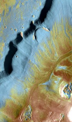 Mamers Valles winds for nearly 1,000 km through the ragged highlands of Arabia Terra, Mars