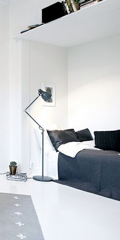 Lofty | TIP: Making use of corners and high ceilings can really increase your room space. | Via NordicDays.nl | Compact Living: One Bedroom Apartment