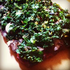 """Easy and delicious! Hearty kale, a zip of lemon, tangy sauce and earthy mushrooms top a meaty """"crust."""""""