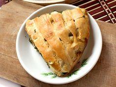 Slice of Chestnut Lentil Bourguignon Pie on white plate
