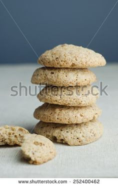 Stack of walnut cookies over white cloth