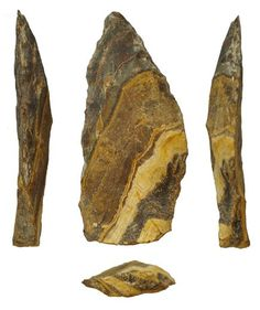 Seen from four angles, a South African stone was likely shaped for a spear..Some of our early human ancestors may have been smarter, and deadlier, than we thought, according to a new study of what may be Earth's oldest stone spear points.If the dating is correct, it suggests our evolutionary forebears mastered the art of the stone-tipped spear half a million years ago—some 250,000 years earlier than previously thought.