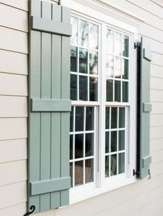 Handmade+custom+shutters+give+the+front+of+this+welcoming+and+well-detailed+home+a+cottage+feel.+