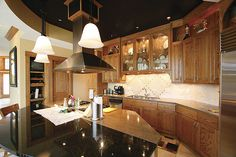 Lake and Home Magazine Cochran Feature Home Kitchen: A mix of light and dark countertops and dark tray ceilings
