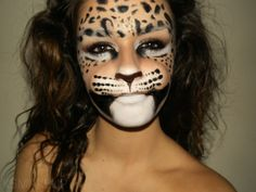 Amazing theatrical leopard makeup - those dumb people who have facial surgery to look like a cat just needed lessons from this artist!