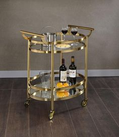 Keep your cooking area organized with this Acme Furniture Lakelyn Clear Glass and Gold Serving Cart. Features metal frame and handle. Diy Bar Cart, Gold Bar Cart, Bar Cart Decor, Bar Carts, Outside Bars, Serving Cart, Mirror With Shelf, Mirror Shelves, Acme Furniture