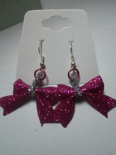 These adorable earrings are handmade by me. They each feature a bright pink sparkly bow attached with bright pink jump rings.