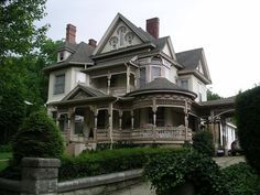I dream about a house like this...all wraparound porches and dormers and chimneys!! Perfect!!