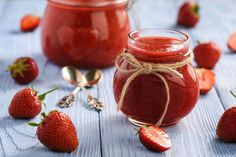 Strawberry jam in glass jar on wooden background.   Recepty.sk