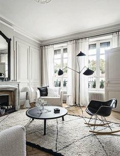 Chic & Charming Apartment In Paris #livingroom #homedecor #interiordesign #rug #rockingchair #french #midcenturymodern
