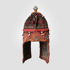 HAT - CHILD'S | Mingei International Museum   c. Mid-20th Century    Culture: Kohistan, Nuristan (?)    Creation Place: Asia, Afghanistan, South-Central Asia