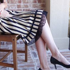 I love the striped skirt with the lace trimmed slip.