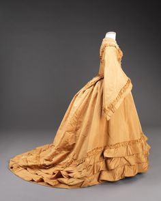 """Wedding Dress: 1851, American, silk. """"...While it is possible that the skirt was re-made for a later bride, there is no obvious indication of that being the case. Wedding clothes have traditionally been vehicles for fantasy and historicism, however, which may be the case in the styling of this one. It nevertheless is a grand dress made for a wedding in Grace Church, a high society Brooklyn house of worship."""""""