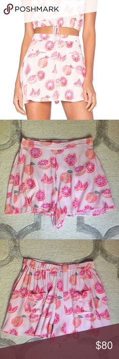 Wildfox grapefruit shorts Wildfox high waisted flowy shorts with grapefruit print. Two back pockets. Elastic waist on back. Worn once, like new condition. Wildfox Shorts