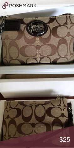 Coach Wristlet Taupe wristlet with signature brown Coach logo and brown handle. New, only used once. I. Great condition. Dimensions L: 6in. W:4in. Coach Bags Clutches & Wristlets