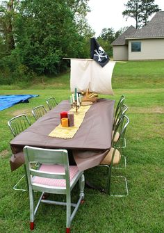 Put a sail at the end of the table to make a ship (no reason it has to be a pirate flag).