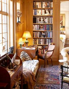 Warm, well-lit beautiful corner with both your  own favorite books, a desk and a beautiful  lamp.