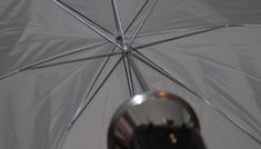 Bounce umbrellas cast broad and relatively uncontrolled light.