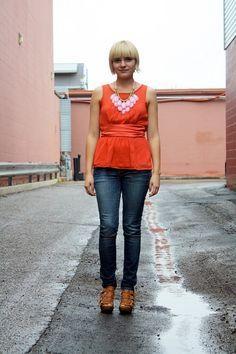 pink statement necklace, orange blouse.