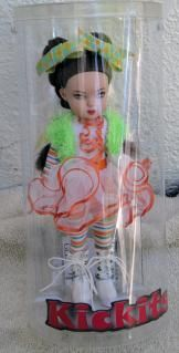 Tonner Sour Apple Snap Kickits Doll 2007 is Item TKS0008 at http://www.dkkdolls.com/store. She is in the Tonner section on the 2nd page. She is 8 inches tall, and has a wonderful whimsical expression and a colorful costume.