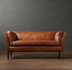 This small sofa is beautiful in the tan leather. I'd like it for a nook or in an office.
