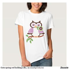 Cute spring owl holding a flower in her beak shirts