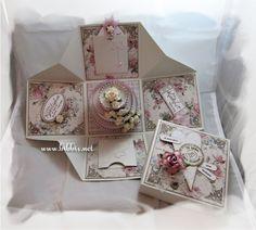 Bryllupskort laget som bokskort med bryllupskake inni. Laget av Bazzill bling og Maja Design ark. Pyntet med glitterhjerte, roser, perler...