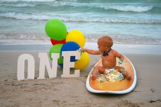 Hey! its my birthday! #1stbirthday #beach #baby #photography #one #balloons #bowtie #surfboard #cake #cakesmash
