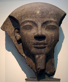 Fragmentary black granite sarcophagus depicting the head of Ramesses VI. Originally from his tomb in the Valley of the Kings in Thebes, circa 1150 BC.