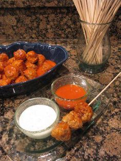 Buffalo Chicken Meatballs~     1 pound ground white meat chicken,  1/2 small onion, grated,  2 cloves garlic, grated,  1/2 cup parsley, chopped I used some dried parsley,  Salt and freshly ground black pepper,  Extra-virgin olive oil (EVOO), for drizzling,  Favorite wing sauce