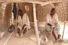 Hausa men using double heddle looms, weaving 1cm width strips to be dyed indigo for Tuareg veils, Kura, Nigeria, 2006. -Duncan Clarke/Adire African Textiles