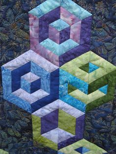 ( 3 videos) Tumbling blocks quilts with the 3-D illusion catches your eye and the interest of other quilters. What used to be a challeng to make with set in seams is now easy with strips and a triangle ruler. The key to making this quilt is in selecting the right fabrics. It is very …