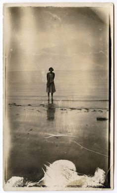 #found photograph of young woman on a beach.