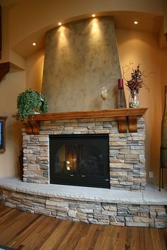 Here you can see the entire fireplace, with hearth, surround, mantle and overmantle.  The arched soffit provides a great termination point and lighting opportunity.