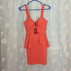 Coral peplum dress Beautiful coral peplum dress. Never worn it didnt fit me to small.. Love Culture Dresses