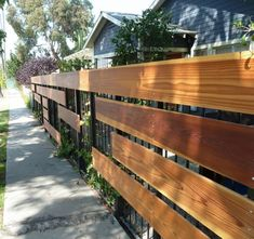 Cool modern fence design with large horizontal boards.