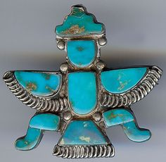 VINTAGE ZUNI INDIAN STERLING SILVER INLAID TURQUOISE KNIFEWING MAN PIN