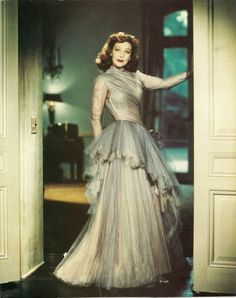 Loretta Young beautiful 40s evening gown silver illusion sheer Hollywood glam movie star long dress side ruffle tulle satin chiffon color photo print ad portrait