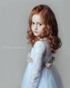 Victoria Anne Photography East Grinstead, West Sussex child portrait Photographer. Child fine art studio portrait. Beautiful red hair. Model portfolio. Studio lighting.