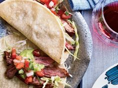 Chile-Spiced Skirt Steak Tacos | In 2006, three brothers—Jesse, Brian and David Vendley—started hawking homemade tacos from a cart on the streets of Soho in Manhattan. In 2009, th...